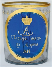 A GLASS MUG COMMEMORATING THE