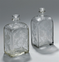 A pair of small vodka flasks