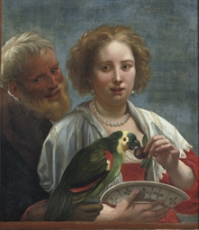 A bearded man and a woman feed