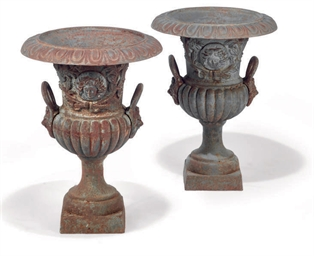 A PAIR OF CAST-IRON GARDEN URN
