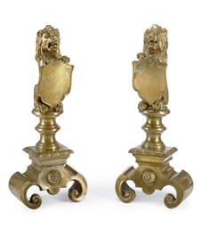 A PAIR OF CAST BRASS ANDIRONS