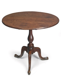 A LATE GEORGE III OAK TRIPOD T