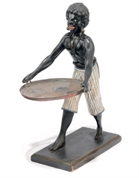 A PAINTED WOOD FIGURE OF A BLA