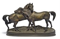 A FRENCH PATINATED BRONZE GROUP ENTITLED 'L'ACCOLADE'