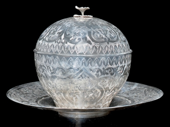 AN OTTOMAN ENGRAVED AND CHASED