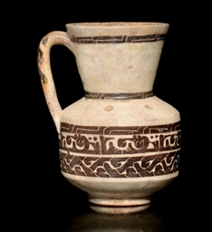 A SAMANID EWER WITH KUFIC INSC