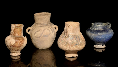 A GROUP OF POTTERY VASES AND T