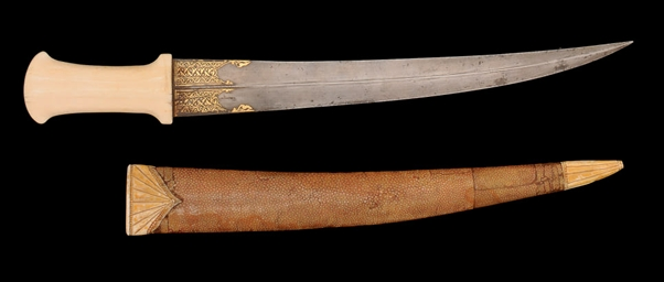 A MARINE IVORY HANDLED QAJAR DAGGER IN A SHAGREEN SHEATH, IR...