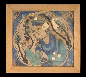 A SAFAVID TILE WITH DRINKING W