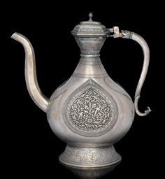 A LARGE SILVER EWER WITH ENGRA