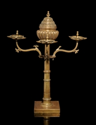 AN INDIAN BRASS OIL LAMP AND I