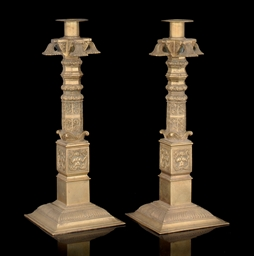 A PAIR OF ENGRAVED BRASS CANDL