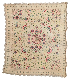 AN EMBROIDERED FLOORSPREAD