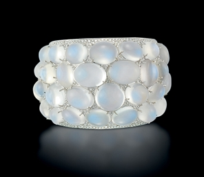 A MOONSTONE AND DIAMOND BANGLE