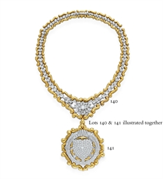 A DIAMOND AND GOLD PENDANT/BRO