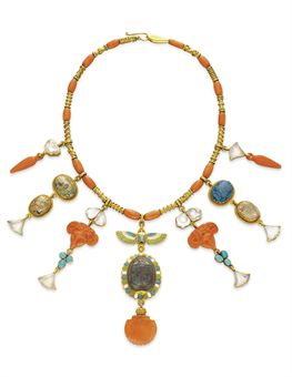 **AN EGYPTIAN REVIVAL CORAL, MULTI-GEM AND GOLD NECKLACE