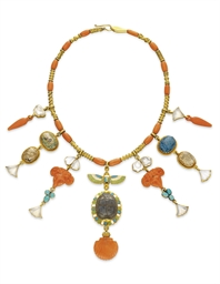 **AN EGYPTIAN REVIVAL CORAL, M