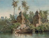 An Indian village on the banks of a river with figures washing at the ghats