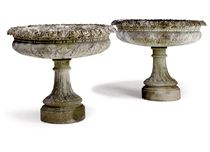 A PAIR OF LARGE COMPOSITE STONE FOOTED JARDINIERES