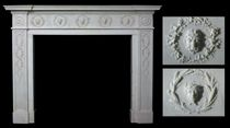 A GEORGE III WHITE STATUARY MARBLE CHIMNEYPIECE