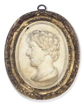 AN ITALIAN CARVED OVAL MARBLE PORTRAIT PROFILE RELIEF OF AN