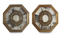 A PAIR OF SPANISH GILTWOOD AND SILVER METAL-MOUNTED REPOUSSE