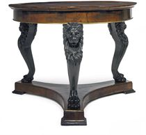 A GERMAN WALNUT AND EBONISED CENTRE TABLE
