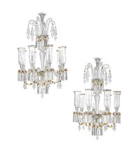 A PAIR OF TURKISH CLEAR AND AMBER-COLOURED CUT AND MOULDED GLASS EIGHT-LIGHT CHANDELIERS