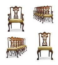 A SET OF TWENTY-SIX WALNUT, BOXWOOD AND MAHOGANY DINING-CHAIRS