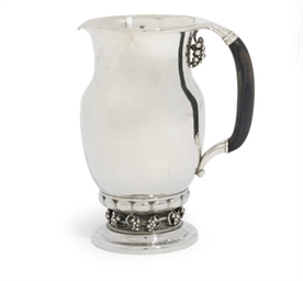 A DANISH WATER-JUG DESIGNED BY
