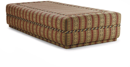 A LARGE UPHOLSTERED OTTOMAN