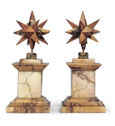 A PAIR OF SIENA MARBLE STAR OR