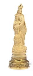 A SPANISH CARVED IVORY FIGURE