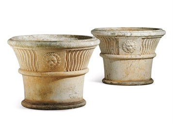 A PAIR OF STONE GARDEN URNS