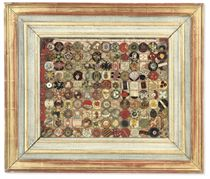 A FRAMED COLLECTION OF NEEDLEWORK BUTTON SAMPLERS