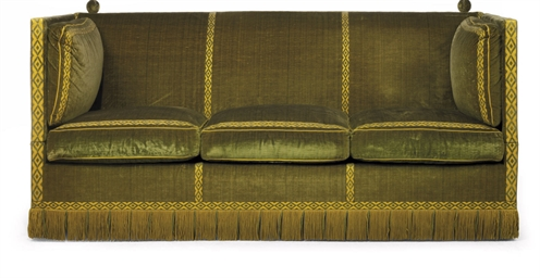 A GREEN VELVET THREE SEAT SOFA