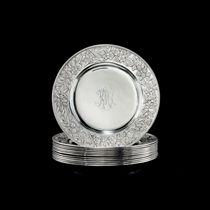 A SET OF TWELVE CHINESE EXPORT SILVER DINNER PLATES