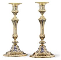 A PAIR OF VICTORIAN SILVER-GILT AND ENAMEL CANDLESTICKS