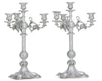 A PAIR OF VICTORIAN SILVER FOUR-LIGHT CANDELABRA