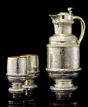 A VICTORIAN VARICOLORED GILT SILVER EWER AND TWO BEAKERS