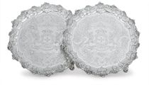 A PAIR OF GEORGE IV SILVER SALVERS OF AMERICAN INTEREST