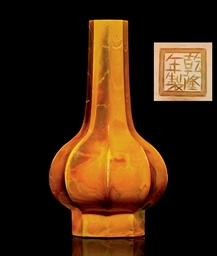 A FLUTED 'REALGAR' GLASS BOTTL