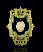 A SMALL CELADON JADE CAT GROUP TOGETHER WITH A STAINED IVORY
