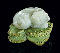 A CELADON JADE LION TOGETHER WITH A STAINED IVORY STAND