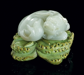 A CELADON JADE LION TOGETHER W