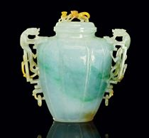 AN APPLE-GREEN JADEITE VASE AND COVER
