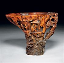 A LARGE RHINOCEROS HORN LIBATION CUP