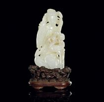 A WHITE JADE CARVING OF A FEMALE IMMORTAL