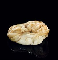 A LARGE JADE CARVING OF A RECUMBENT LION