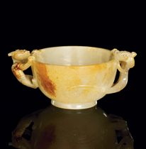 A JADE TWIN-HANDLED CUP